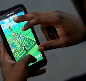 "A man plays the augmented reality mobile game ""Pokemon Go."" REUTERS/Mark Kauzlarich/File Photo"