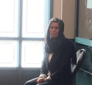 Premier Wynne sits in the back of the mosque