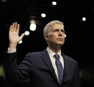 Supreme Court nominee Neil Gorsuch is sworn in as he prepares to testify at his confirmation hearing. REUTERS/James Lawler Duggan