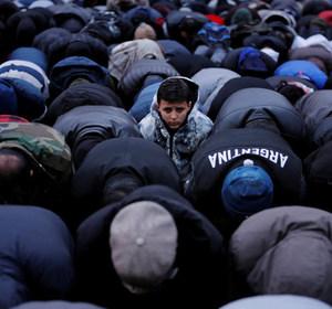 A little boy looking up during a prayer demonstration. REUTERS/Lucas Jackson