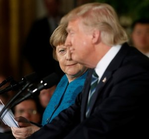 Germany's Chancellor Angela Merkel and U.S. President Donald Trump after a comment about wiretapping. REUTERS/Aaron P. Bernstein