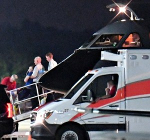 Otto Warmbier is transferred from a medical transport airplane to an ambulance. REUTERS/Bryan Woolston.