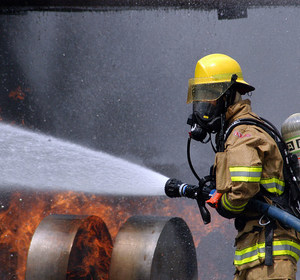 firefighter douses fire