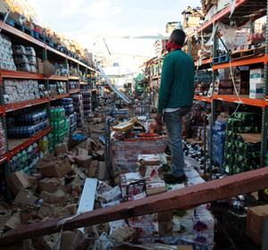 A man stands inside of a destroyed supermarket by Hurricane Maria in Salinas, Puerto Rico, September 29, 2017 REUTERS/Alvin Baez