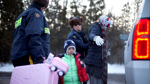 A family is arrested as they cross the boarder into Canada illegally. REUTERS/Christinne Muschi