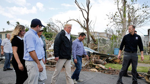 Trump surveys the damage in Puerto Rico during his visit. REUTERS/Jonathan Ernst