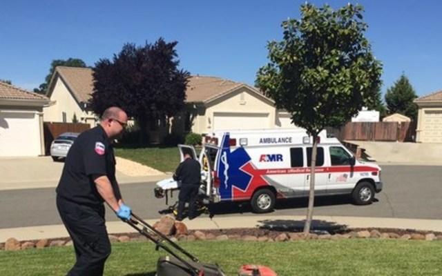 EMT mowing lawn