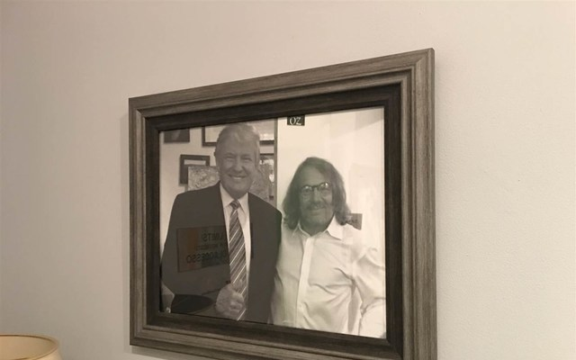 A framed picture of Donald Trump and Harold Bornstein in the physician's office