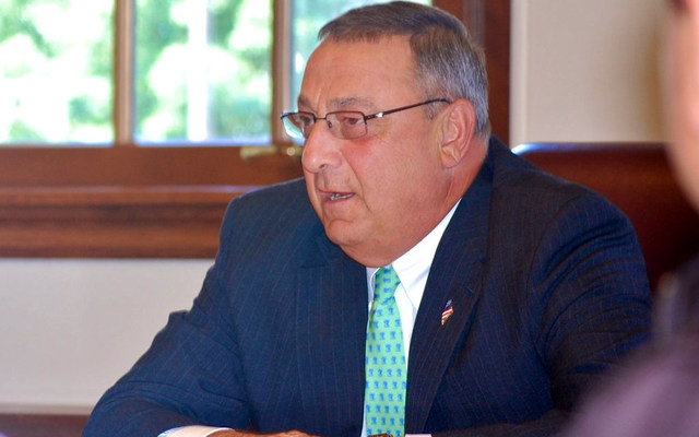 LePage sitting down at an event for international Maine teachers