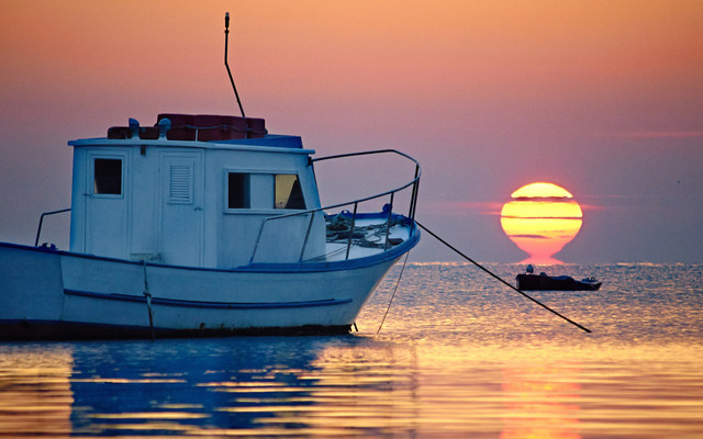 A fishing boat goes out to sea