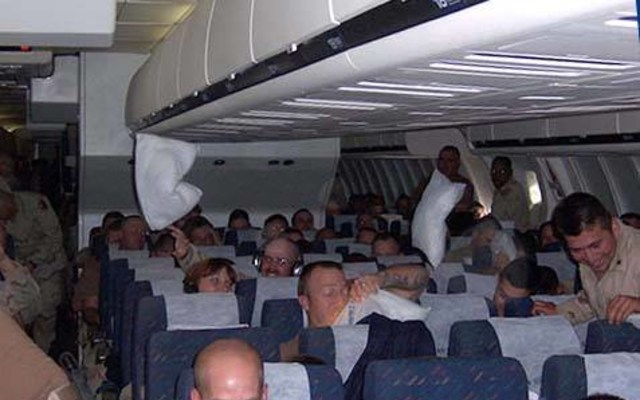 soldiers on a flight