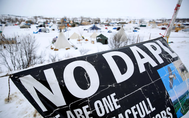 A banner flying by the Dakota Access pipeline protest camp. REUTERS/Terray Sylvester