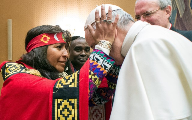 Pope Francis greeted at a meeting with indigenous people.