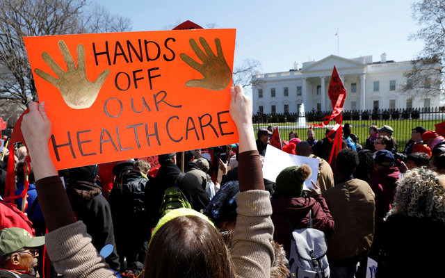Demonstrators protesting President Donald Trump's plans to repeal Obamacare. REUTERS/Kevin Lamarque