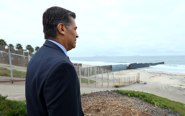 Attorney General of California Xavier Becerra looks out at the U.S.-Mexico border. REUTERS/Mike Blake
