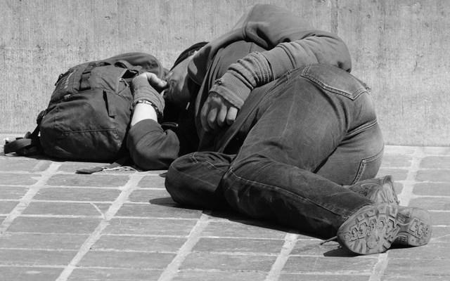a homeless man sleeping