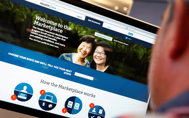 A man looks over the Affordable Care Act signup page on the HealthCare.gov website in New York in this photo illustration. REUTERS/Mike Segar