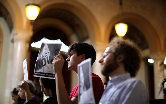 Immigrant supporters protest at a Los Angeles City Council meeting. REUTERS/Lucy Nicholson