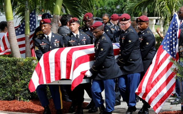 An honor guard carries the coffin of U.S. Army Sergeant La David Johnson, who was among four special forces soldiers killed in Niger, at a graveside service in Hollywood, Florida, October 21, 2017. REUTERS/Joe Skipper