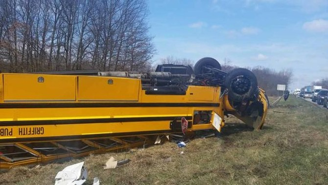 School bus turned upside-down after the accident