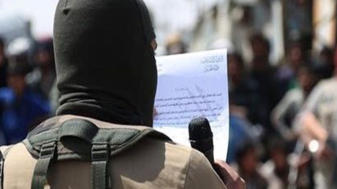 An ISIS Militant Reads A Statement Before Executing A Child