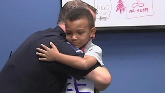 5-year-old Jayden Hooker hugs Charlotte police officer