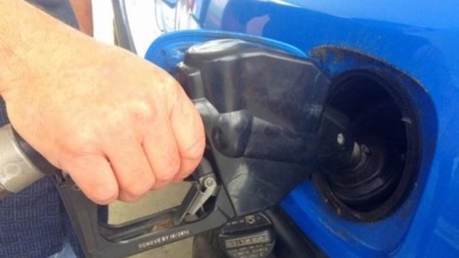 a man pumping gas