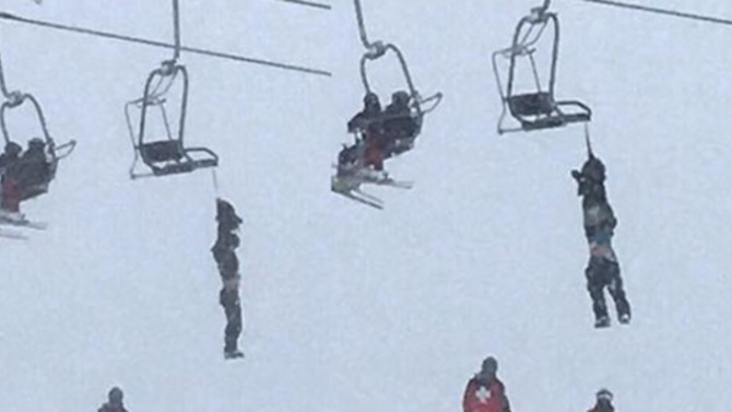 Mickey Wilson rescues his friend from a ski lift
