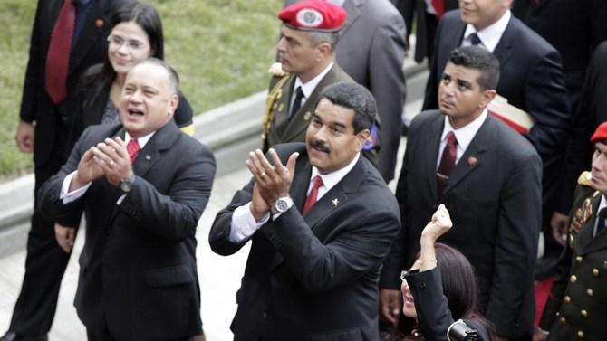 Venezuelan president Nicolas Maduro (center)