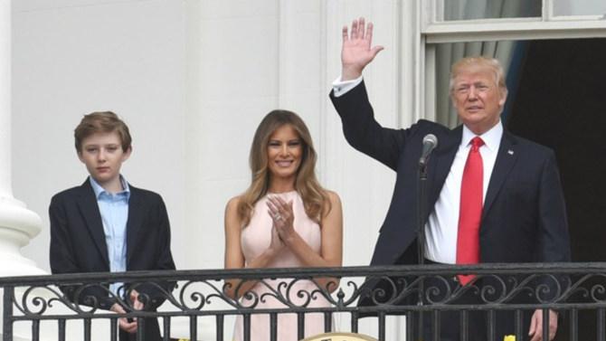 Barron, Melania, and Donald Trump on balcony