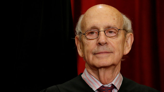 U.S. Supreme Court Justice Stephen Breyer participates in taking a new family photo with his fellow justices. REUTERS/Jonathan Ernst