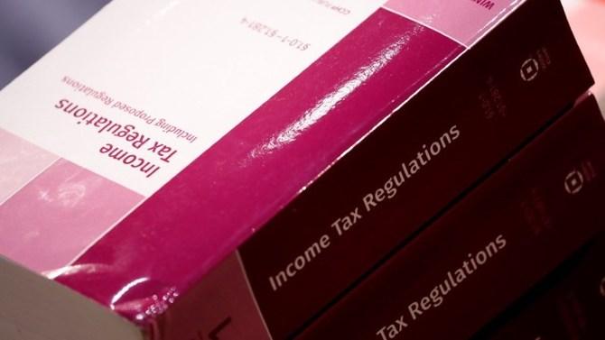 Books of income tax regulations. REUTERS/Aaron P. Bernstein